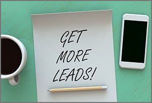 image of smart phone and coffee between them is a sign reading get more leads