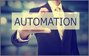 man holding card that reads marketing automation