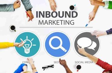 inbound-marketing-team-hands-on-a-table