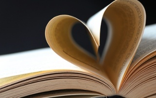 bigstock-Pages-Of-A-Book-Curved-Into-A--20860280.jpg